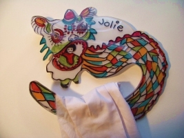 Acrylic blanket hanger, shaped and painted as a dragon