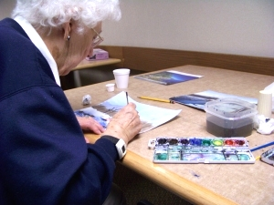 Painting postcards to her grandchildren