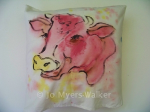 Bossy tries on some colors (painted pillow by Jo Myers-Walker)