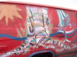 St. Clare mural on red van, by Jo Myers-Walker