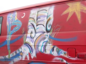 St. Francis mural on red van, by Jo Myers-Walker
