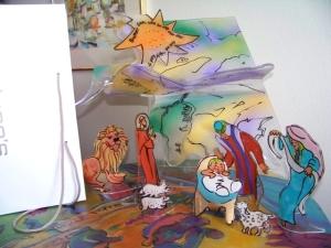 Acrylic figures loading tree into bag for storage