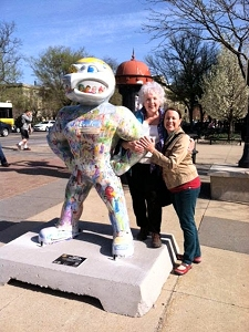 Herky on Parade 2 statue painted by Jo Myers-Walker, being hugged
