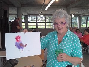 Jo with painting done at Iowa State Fair demonstration