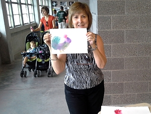 Liz with painting done at Iowa State Fair demonstration