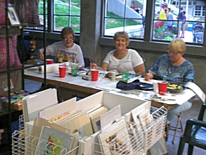 Painting table at the 2014 Iowa State Fair booth