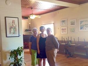 Jo Myers-Walker, Leslie Leavenworth, and Jan Vander Linden after hanging their artwork at Salt Fork Kitchen in Solon, Iowa