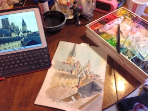 Watercolor painting using a photo of Rouen rooftops for reference