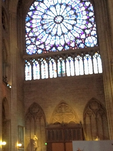 Stained-glass rose window viewed from inside Notre-Dame Cathedral, Paris