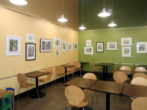 Community art gallery at Wheatsfield Co-op in the deli seating area