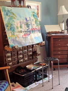 Old card catalog from ISU library being used as an easel for large watercolor
