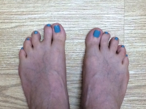 Toes with aqua blue polish
