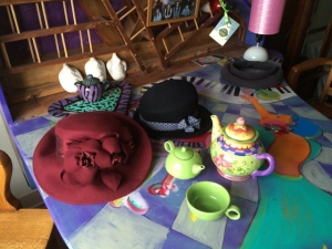 Hats arranged with tea set