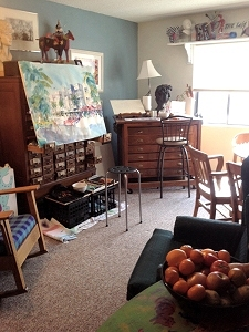 View of living room showing card-catalog easel next to drafting table