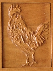 Jo's rooster - detail of carved wood plaque by Bob Clymer