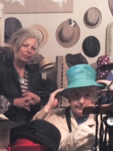 Jo Myers-Walker trying on a hat at La Boutique de Maman