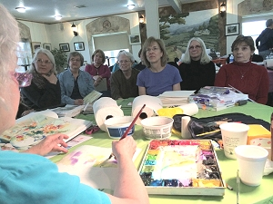 Class watching Jo Myers-Walker demonstrate painting technique at Summerset Winery