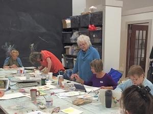 Artists in watercolor workshop at Art Center of Burlington