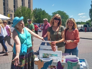 Jo selling from art cart at 2016 Iowa Arts Festival