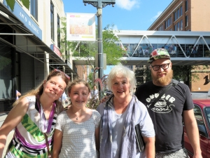 Jo Myers-Walker with family members at reveal of artwork installed on Cedar Rapids skywalk