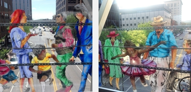 Detail of figures from sculpture by Jo Myers-Walker viewed from inside Cedar Rapids skywalk