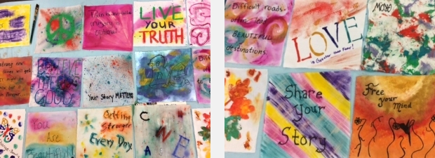 Quilt squares painted with empowering messages by workshop participants