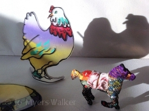 Slumped-acrylic sculpture of chicken and fabric-wrapped horse figure by Jo Myers-Walker