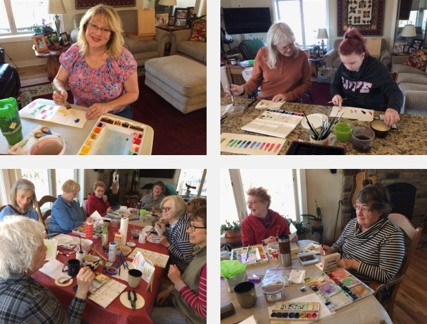 Artists painting at a watercolor workshop facilitated by Jo Myers-Walker