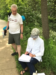 Artists sketching en plein air along Iowa City path