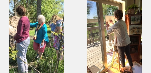 Artists at a workshop near Nevada, Iowa, looking for subjects in nature to paint