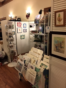 Jo Myers-Walker's booth at the 2017 Eastside Artists show and sale, with small watercolors, prints, cards, pillows