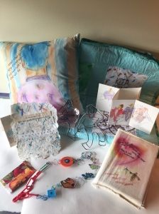 Examples of fun art projects, paper making, painting on fabric, pop-up card, fun jewelry