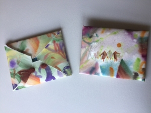 Watercolor paper hand painted to make pouches to bundle notecards