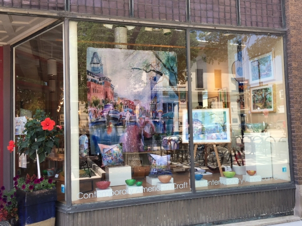 Storefront of Iowa Artisans Gallery in Iowa City, IA featuring works by artist Jo Myers-Walker