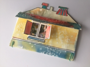 Watercolor painted pouch made in the shape of a house