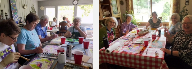 Two different groups of people watercolor painting at tables full of supplies and painted papers
