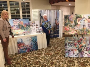 Artist Jo Myers-Walker with stretched fabric prints and shower curtain digitally printed with images of her watercolor paintings