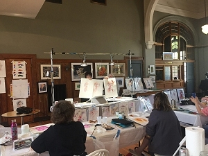Painters working at a watercolor workshop led by Janet Rogers