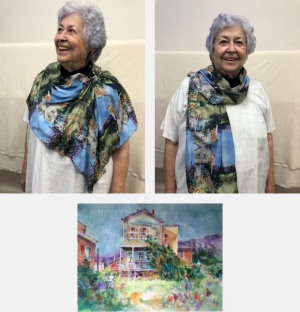 Model wearing scarf printed with watercolor painting Backyard Chickens by Jo Myers-Walker
