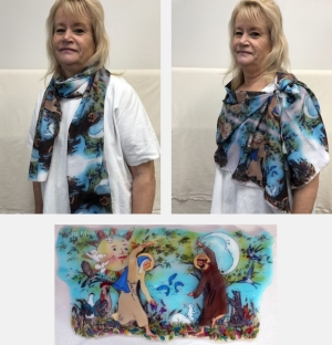 Model wearing scarf printed with image of Canticle of Creation sculpture by Jo Myers-Walker