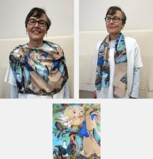 Model wearing scarf printed with detail of St. Clare from Canticle of Creation sculpture by Jo Myers-Walker
