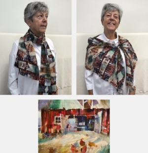 Model wearing scarf printed with images from Red Barn watercolor painting by Jo Myers-Walker