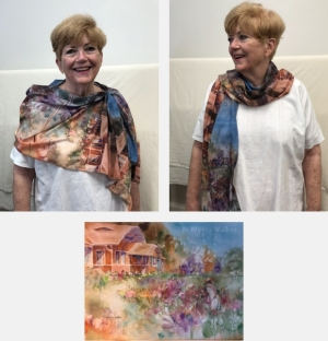 Model wearing scarf printed with images of watercolor painting Nikki's House by Jo Myers-Walker