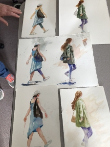 Different students' painting of the same sketch of walking figures to practice watercolor shading technique
