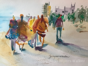 Watercolor painting of people in brightly-colored clothing walking along a Florida beach by Jo Myers-Walker