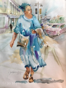 A woman in a flowing dress walks along Iowa Avenue in Iowa City, watercolor painting by Jo Myers-Walker