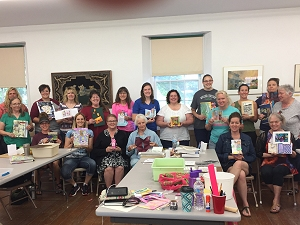 Group photo of educators participating in Artistic Journal Making workshop led by artist Jo Myers-Walker