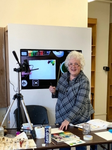 Jo Myers-Walker leading a watercolor workshop with video camera displaying what she paints