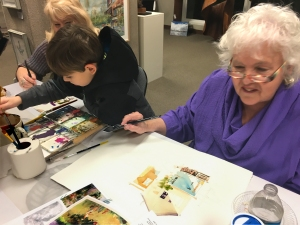 Jo Myers-Walker demonstrate watercolor painting at the opening of a show at Bereskin Gallery & Art Academy with help from friend Jeanette and a young art student