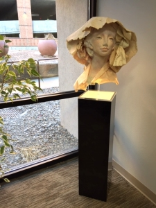 Marisa, handmade paper bust of a young woman in a draping hat by artist Jo Myers-Walker